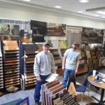 men standing near hardwood flooring samples
