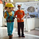 person dressed as Bob the Builder with young man