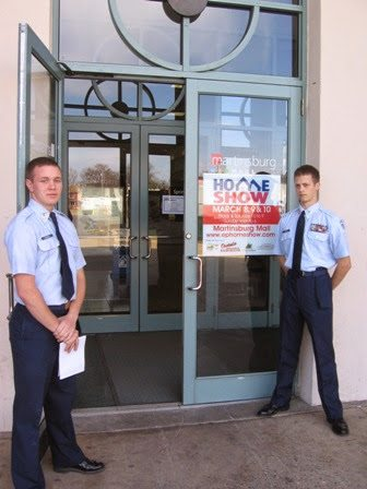 men standing in front of door with a sign for the EPHBA home show